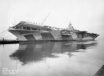 Port side view of Essex-class carrier Ticonderoga receiving final preparations at Newport News Naval Shipyard before being delivered to the US Navy, Newport News, Virginia, Untied States, Apr 22, 1944.