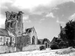 Two disabled M4 Sherman tanks and a litter Jeep near the heavily damaged Église Saint-Ouen in Rots, France (near Caen), Jun 11, 1944.