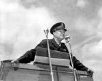 General Dwight D. Eisenhower preparing to make an address at an outdoor podium, 1944. Location unknown.