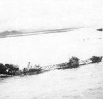 Large Type 2TL tanker Kyokuun Maru on fire and making for the beach off the coast of French Indochina (Vietnam) north of Qui Nhon after its convoy was attacked by 175 United States Navy carrier planes, Jan 12, 1945.