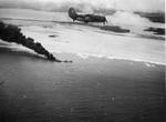SB2C-3 Helldiver from USS Hornet (Essex-class) overflying burning tanker Kyokuun Maru heading for the beach in French Indochina (Vietnam) north of Qui Nhon after being attacked by 175 USN carrier planes, Jan 12, 1945