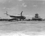 Sikorsky R-4B Helicopter delivering spare aircraft parts to the B-29 base at North Field, Tinian, Mariana Islands, 11 Apr 1945.