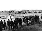 P-51D Mustangs of the 47th & 531st Fighter Squadrons at South Field, Iwo Jima, May-July 1945. Note also the PB4Y-1 Liberator of Navy Patrol Squadron VPB-116.