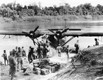 A PBY-5 Catalina of US Navy Patrol Squadron VP-11 on the Sepik River in Australian New Guinea bringing supplies to a coast-watcher working in the area, Jan 1943