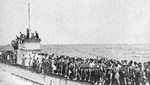 German U-156 with its decks crowded with survivors from the British RMS Laconia prior to the submarine being attacked by an American bomber, Sep 15, 1942.
