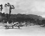 F4U-1 Corsairs of Marine Squadron VMF-214 taxiing for take-off at Torokina Airstrip, Bougainville, Solomons, 1943
