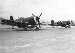 Marine Corps F4U-1D Corsairs prepare for take-off from their base on Okinawa, 1945. Note the two oversized drop tanks beneath the fuselage.