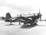 F4U-1D Corsair of Marine Squadron VMF-422 at Ie Shima Airfield, Ie Shima, Okinawa, Japan, 1945. Note the nose art on both the plane and the belly tank.