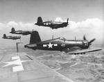FG-1D Corsairs of Marine Squadron VMF-323 flying over Okinawa, Japan, 1945