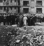 King George VI and Queen Elizabeth visit the site of the last V2 to fall on London on Mar 27, 1945 at Vallance Road, Stepney, in the East End, London and 134 people were killed, mostly Jewish refugees, Oct 4, 1945