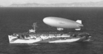 K-class airship K-29 of Airship Patrol Squadron ZP-31 lifts off the flight deck of escort carrier USS Altamaha off the California coast, Feb 24, 1944.