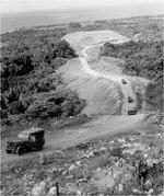 US Army Jeeps driving up Wright Road toward the area of the Japanese Gifu strongpoint on Guadalcanal, Solomon Islands, 1942.