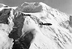 Three Lockheed A-29 Hudsons fly past Mt McKinley, Territory of Alaska, circa 1942