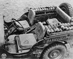 A Jeep packed with mortar shells, a mortar tube between the seats, and the mortar plate on the floor, New Caledonia, 1942.