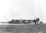 WC-54 ambulances waiting for returning B-24 Liberator bombers of the 453rd Bomb Group at Old Buckenham in England, United Kingdom, Mar 16, 1944