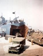 LST-357 at a port in southern England being loaded with DUKWs in preparation for the D-Day Normandy invasion, early June 1944.