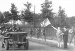Members of the 327th Glider Infantry Regiment, 101st Airborne, driving from Eindhoven to Nijmegen, Netherlands as part of Operation Market Garden are cheered by Dutch citizens, about Sep 18, 1944.