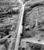 The first convoy to use new Ledo Rd at Mile Zero marker at the railhead of Ledo, India, Jan 12, 1945.  The Ledo Road connected with the old Burma Road as part of the effort to truck supplies to Kunming, China