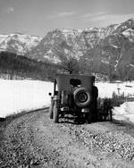 A Jeep from the US Tenth Mountain Division pauses along the road to the Riva Ridge in northern Italy, Feb 1945.