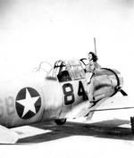 WASP pilot Violet Wierzbicki on the wing of a Vultee BT-13 Valiant, 1943. Location unknown.