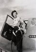 WASP pilot Vivian Eddy in the door of a P-39 Airacobra, 1945. Location unknown.