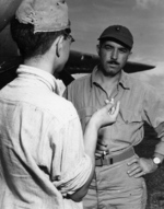 USMC 2Lt Gordon Growden, combat correspondent, interviews Japanese POW 2Lt Minoru Wada prior to a bombing mission against the prisoner's former headquarters, Zamboanga, Mindanao, Aug 9, 1945
