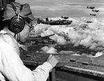 From the radio operator's position in a USMC PBJ Mitchell, Japanese POW 2Lt Minoru Wada looks for landmarks to find the Japanese 100th Infantry Division headquarters complex, Aug 9, 1945, Mindanao, Philippines