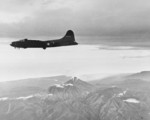 B-17F Fortress flying past Mt. Bagana on Bougainville, Solomon Islands, Nov 11, 1942. This aircraft is returning from bombing Buka Island and is on its way to bomb Shortland Harbor at opposite the end of Bougainville