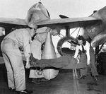 "A ""patient"" being prepared for transport during a drill, 1944. The aircraft is an F-5B Lightning fitted with two drop tanks modified for use in high speed medevac operations"