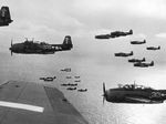 TBM Avengers and SB2C Helldivers flying from the carrier Bunker Hill, western Pacific, Feb 1945