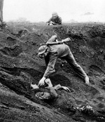 This Japanese soldier played dead for almost two days half buried in a shell hole holding a live grenade. Promising no resistance, he was given a cigarette before being removed from the hole, Iwo Jima, Mar 16, 1945