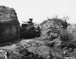 A Japanese tank wedged between banks of solid earth was very difficult for US Marines to see or attack from the front, Iwo Jima, Mar 25, 1945.
