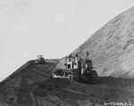 A Bulldozer with the US Marines 32nd Sea Bees cutting a road to the summit of Mt Suribachi, Iwo Jima, Mar 10, 1945.  In 50 years of occupation, the Japanese had never built a road to the top of Suribachi.