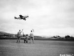 A North American P-51D Mustang of the Vll Fighter Command taking off from Saipan, Mariana Islands for the newly-captured airfield on Iwo Jima, Mar 16, 1945. Note the twin oversized VLR drop tanks.