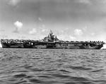 Broadside view of the port side of the USS Hornet (Essex-class) at anchor showing her Dazzle MS33/3a paint scheme, 1944, probably at Ulithi.
