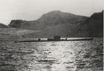 Type IXC/40 submarine U-537 at anchor in Martin Bay, Labrador, Newfoundland (now Canada) on 22 Oct 1943. Crewmen can be seen on deck offloading components of Weather Station Kurt into rubber rafts.