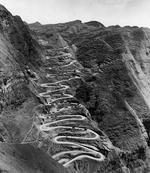 The 24-Turns section of the Kunming-Chungking (Chongqing) Road in China climbs 650 vertical feet using 1.8 miles of road to cover one-quarter of that distance laterally, Guizhou Province, China, 1944, photo 1 of 2