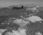 "Curtiss C-46 Commando flying over ""The Hump"" between China, Northern Burma (now Myanmar), and eastern India, 1944."