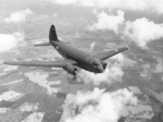Curtiss C-46 Commando in flight, early 1943, probably over the United States.