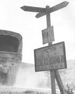 Sign post at Mong Yu, Burma (now Myanmar) at the Chinese border marking the joining of the newer Ledo Road with the previous Burma Road, 1945