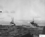 Oceangoing tug USS Abnaki takes the captured Type IXC submarine U-505 under tow, 7 Jun 1944. U-505 was captured three days earlier by the USS Guadalcanal hunter group. Photo 3 of 3.
