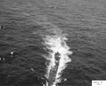Abandoned by her crew but with engines still running, German Type IXC submarine U-505 circles at 7 knots before US boarding parties complete the capture off the West African coast, 4 Jun 1944.