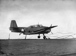TBF-1 Avenger landing on Auxiliary Carrier USS Card bounced over the arresting cables, crashed the barrier, and stopped in an anti-aircraft gun tub, 9 Dec 1942 off San Diego, California, United States. 1 of 2.