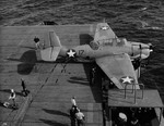 TBF-1 Avenger landing on Auxiliary Carrier USS Card bounced over the arresting cables, crashed the barrier, and stopped in an anti-aircraft gun tub, 9 Dec 1942 off San Diego, California, United States. 2 of 2.