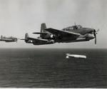 A training flight of TBF-1 Avengers lining up to drop practice torpedoes, late 1942, off the east coast of the United States. Photo 1 of 4.