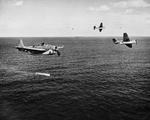 A training flight of TBF-1 Avengers lining up to drop practice torpedoes, late 1942, off the east coast of the United States. Photo 3 of 4.