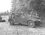 US Army troops in a captured Kübelwagen in France, 1945. Note that the censors have removed the front bumper markings.