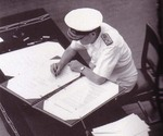 Admiral Sir Bruce Fraser signing the surrender instrument on behalf of the United Kingdom aboard USS Missouri, Tokyo Bay, Japan, 2 Sep 1945, photo 3 of 3