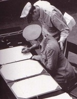 Colonel Lawrence Cosgrave signing the surrender instrument on behalf of the Dominion of Canada aboard USS Missouri, Tokyo Bay, Japan, 2 Sep 1945.