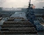 The colors being hoisted for the first time aboard the USS Yorktown (Essex-class) during the ship's commissioning ceremonies, 15 Apr 1943 at Norfolk, Virginia, United States